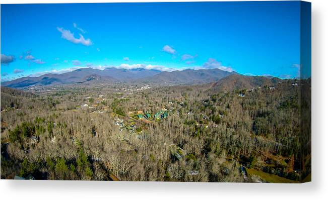 Aerial Canvas Print featuring the photograph Aerial View On Mountains And Landscape Covered In Snow by Alex Grichenko