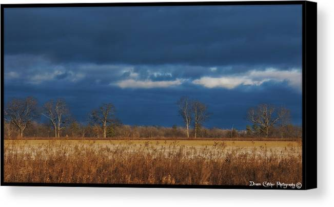 Field Canvas Print featuring the photograph Before The Storm by Vincent Dwyer
