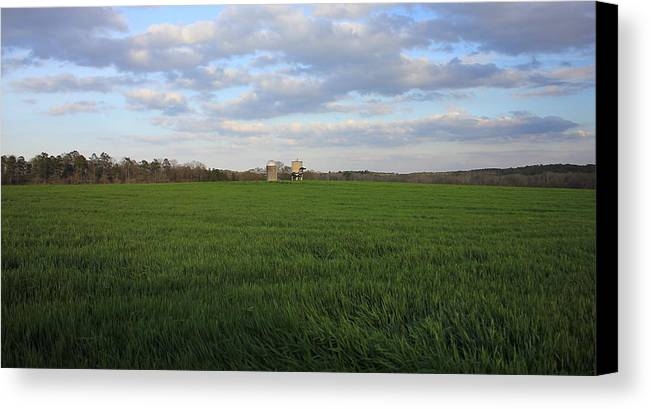 The Iron Horse Canvas Print featuring the photograph Great Friends Iron Horse Wheat Field And Silos by Reid Callaway