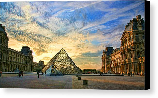 France Canvas Print featuring the photograph The Louvre At Sunset by Chuck Kuhn
