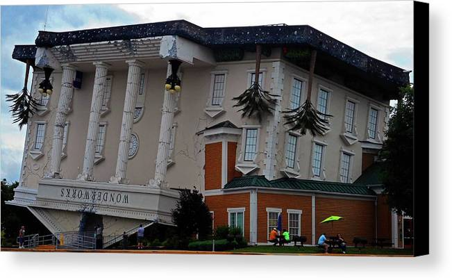Pigeon Forge Canvas Print featuring the photograph Upside Down Building by Ron Kandt