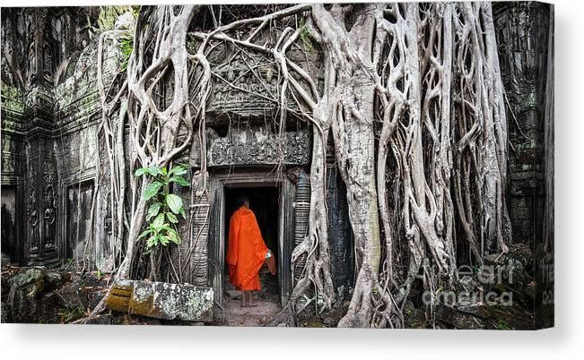 Civilization Canvas Print featuring the photograph Monk In Angkor Wat Cambodia. Ta Prohm by Banana Republic Images