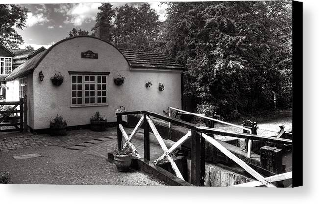 Canal Canvas Print featuring the photograph Canal Cottage by Dave Perks