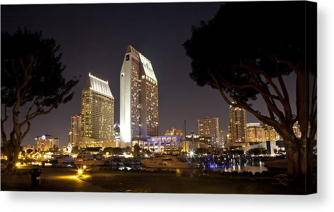 Hotels Canvas Print featuring the photograph Waterfront Hotels At Night by Joe Darin