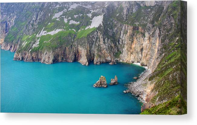 Slieve League Canvas Print featuring the photograph turquoise sea at Slieve League cliffs Ireland by Pierre Leclerc Photography