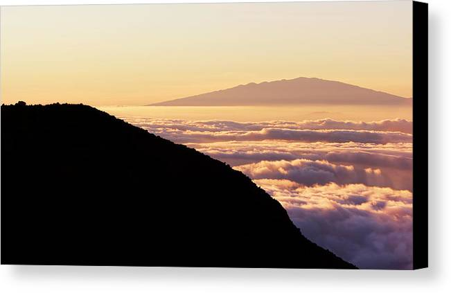 Alpine Canvas Print featuring the photograph Mountain Top Above The Clouds by Design Pics Vibe