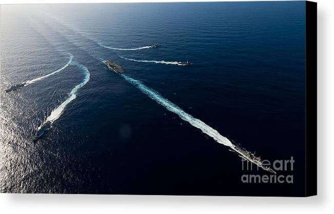 Uss John C Stennis Canvas Print featuring the photograph Ships From The John C. Stennis Carrier by Stocktrek Images