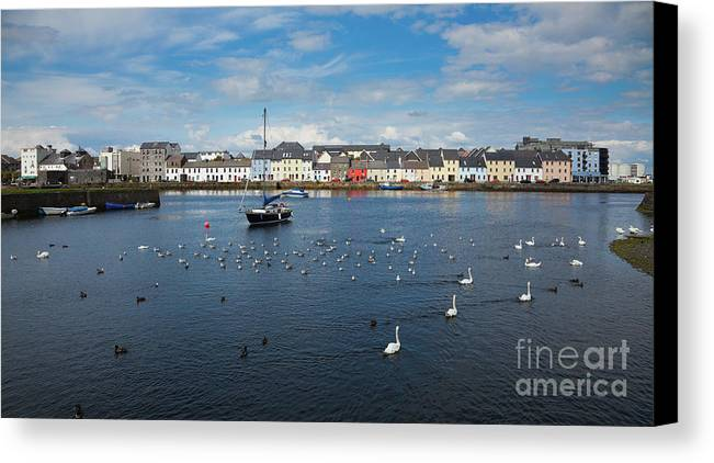Claddagh Canvas Print featuring the photograph The Claddagh Galway by Gabriela Insuratelu