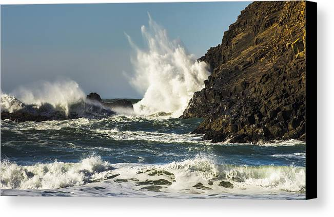 Cannon Beach Canvas Print featuring the photograph Water Meets Rock by John Trax