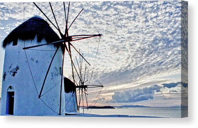 Seascape Canvas Print featuring the photograph Wind Mills Of Mykonos by Linda Pulvermacher