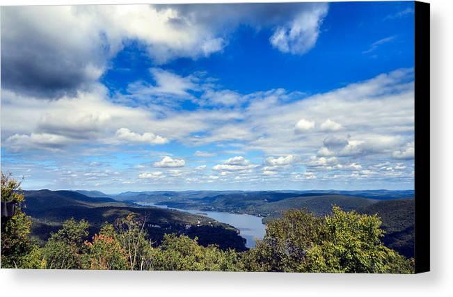 Sky Canvas Print featuring the photograph Cloud Pockets by Art Dingo