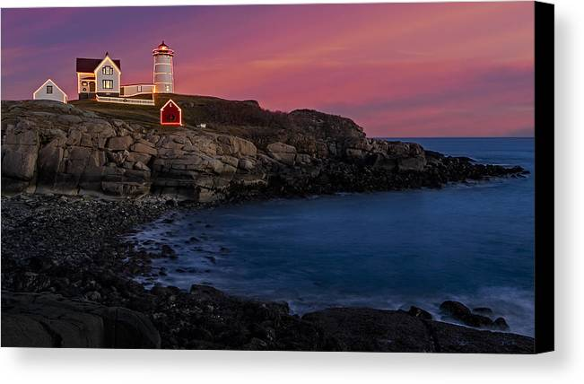 Nubble Lighthouse Canvas Print featuring the photograph Nubble Lighthouse At Sunset by Susan Candelario
