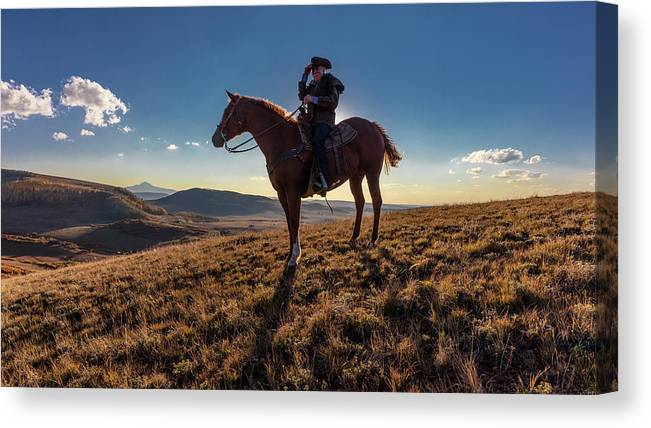 Photography Canvas Print featuring the photograph Cowboy Looks Out Over Historic Last by Panoramic Images