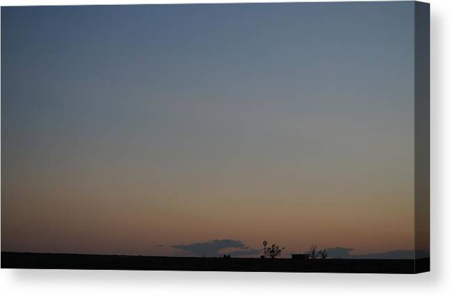 Colorado Farm Windmill Evening Silhouette Cloud Sky High Plains Prairie Tree Building Landscape Outdoors Canvas Print featuring the photograph High Plains Farm With Windmill As Evening Begins by Bryce Fellbaum