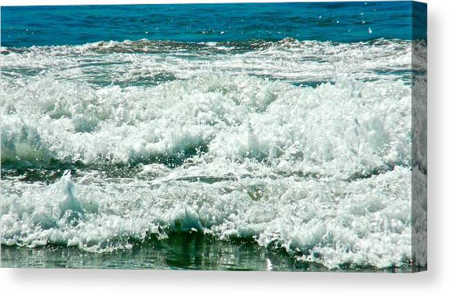 Ocean Waves Canvas Print featuring the photograph Wading For A Sign by Jacqueline Howe