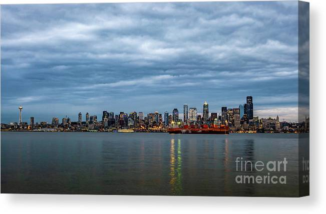 Clouds Canvas Print featuring the photograph Panorama Of Seattle Skyline At Night With Storm Clouds by PorqueNo Studios