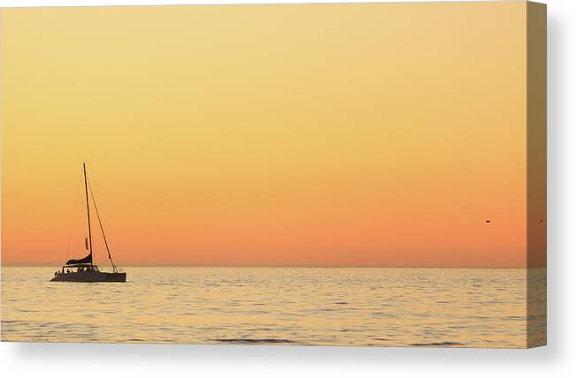 Clear Sky Canvas Print featuring the photograph Sunset Cruise At Cape Town by Tony Hawthorne