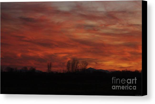 Sunset Canvas Print featuring the photograph Evening In Red by Deborah Benoit