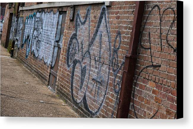 New Orleans Canvas Print featuring the photograph The Art On The Brick by My NOLA Eye