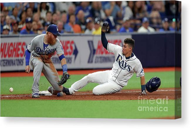 People Canvas Print featuring the photograph Justin Turner And Willy Adames by Mike Carlson