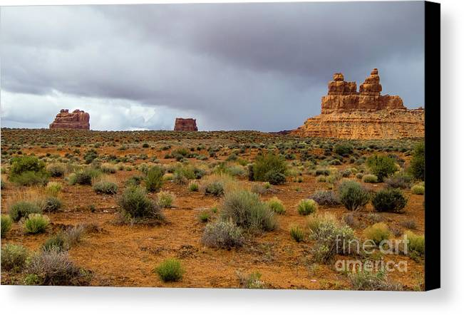 Valley Of The Gods Canvas Print featuring the photograph Clouds Coming by Jerry Sellers