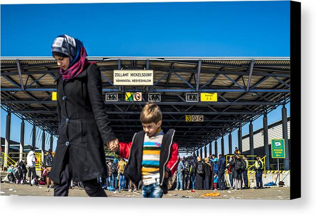 Migrants Canvas Print featuring the photograph migrants in Nicklesdorf by Gabor Tokodi