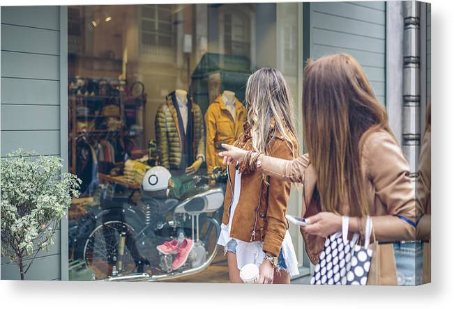 5ca3ca17ff7a7 Mid Adult Women Canvas Print featuring the photograph Two Women Looking At Shop  Window Of A