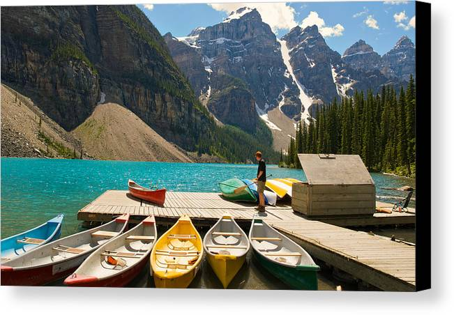 Canoes Canvas Print featuring the photograph Moraine Lake - Banff National Park - Canoes by Andre Distel