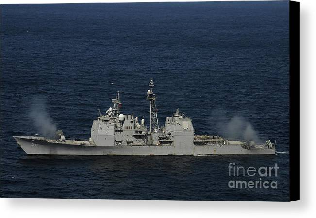 Side View Canvas Print featuring the photograph Uss Bunker Hill Fires Two Mk-45 5 by Stocktrek Images