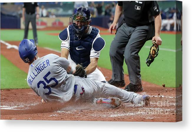 People Canvas Print featuring the photograph Los Angeles Dodgers V Tampa Bay Rays 1 by Mike Carlson