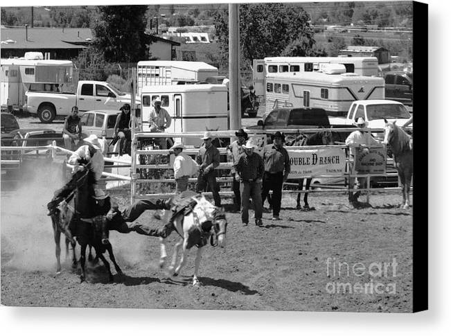 Rodeo Canvas Print featuring the photograph Steer Wrestling by Susan Chandler