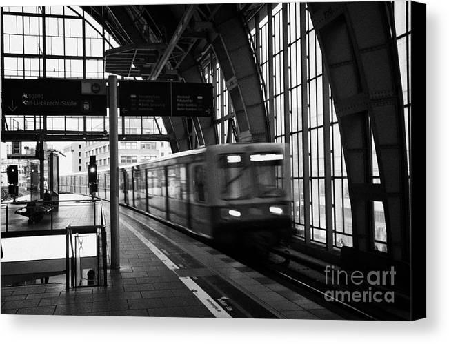 Berlin Canvas Print featuring the photograph Berlin S-bahn Train Speeds Past Platform At Alexanderplatz Main Train Station Germany by Joe Fox
