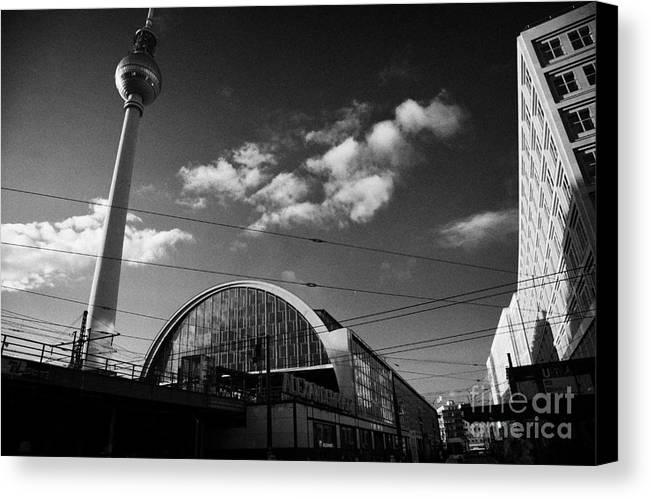 Berlin Canvas Print featuring the photograph berliner fernsehturm Berlin TV tower symbol of east berlin and the Alexanderplatz railway station by Joe Fox