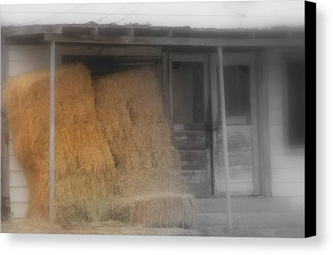 Hay Stacks Canvas Print featuring the photograph east Texas.. by Al Swasey