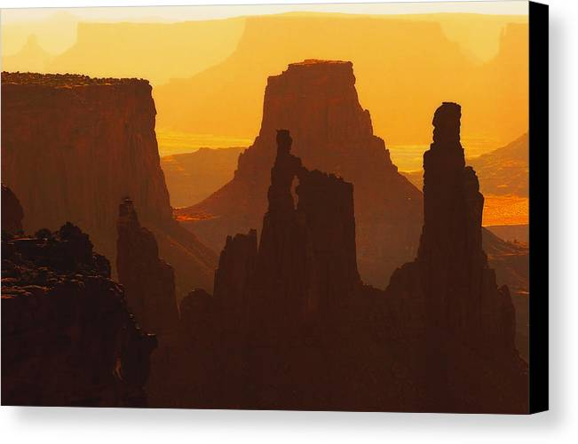 Desert Canvas Print featuring the photograph Hazy Sunrise Over Canyonlands National Park Utah by Utah Images