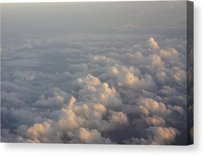 06000000 Canvas Print featuring the photograph Cumulus Clouds At Sunset by Jon Van de Grift