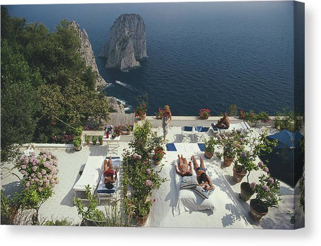 1980-1989 Canvas Print featuring the photograph Il Canille by Slim Aarons