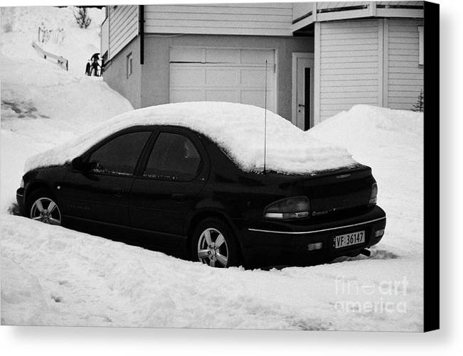 Car Canvas Print featuring the photograph Car Buried In Snow Outside House In Honningsvag Norway Europe by Joe Fox