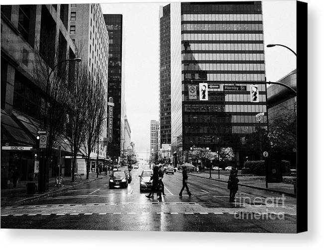 Crosswalk Canvas Print featuring the photograph crosswalk at west georgia and hornby downtown in the rain Vancouver BC Canada by Joe Fox