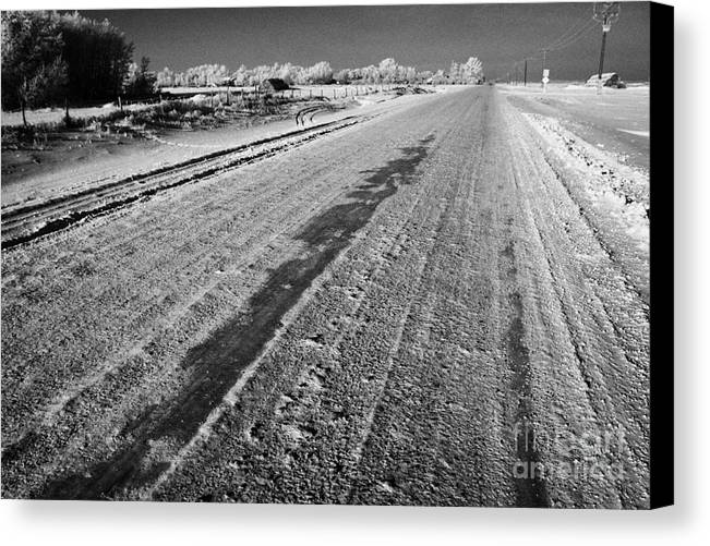 Salt Canvas Print featuring the photograph frozen salt and grit covered rural small road in Forget Saskatchewan Canada by Joe Fox