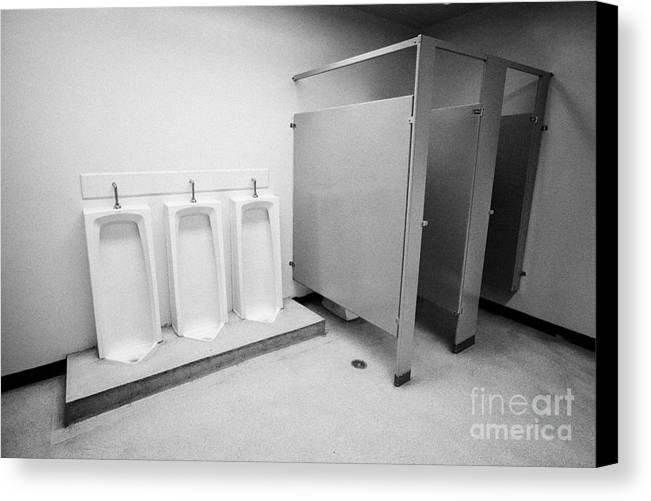 Toilet Canvas Print featuring the photograph full length urinals and cubicles in mens toilet of High school canada north america by Joe Fox