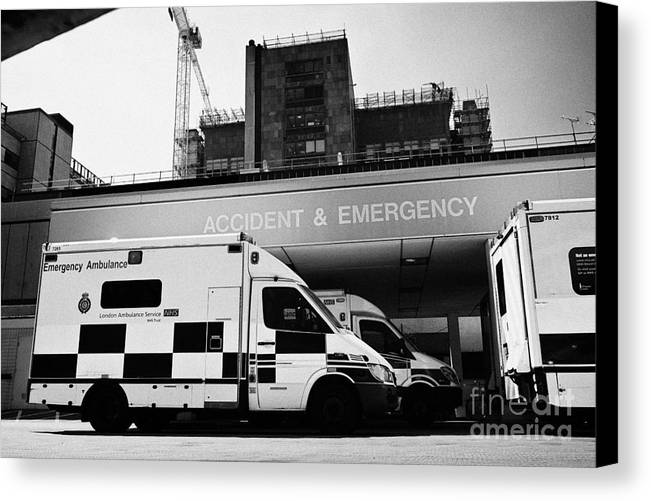 Accident Canvas Print featuring the photograph hospital accident and emergency entrance with ambulances London England UK by Joe Fox