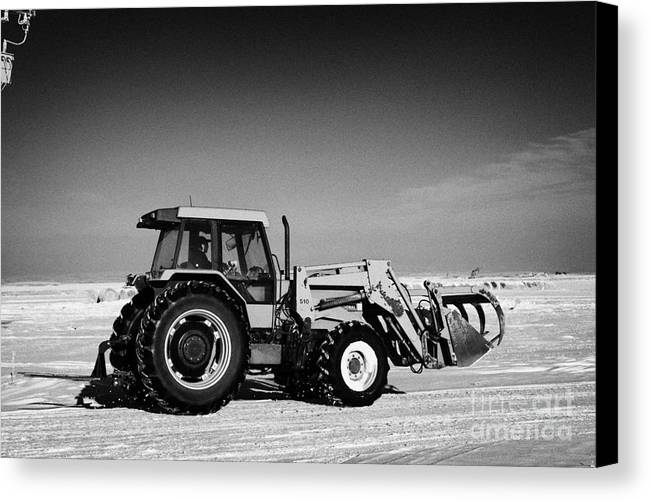 International Canvas Print featuring the photograph international 5140 tractor with front end loader on frozen field Forget Saskatchewan Canada by Joe Fox