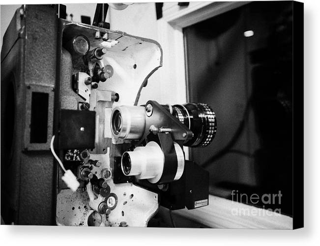 Old Canvas Print Featuring The Photograph Lenses On Film Projector In Cinema Projection Room