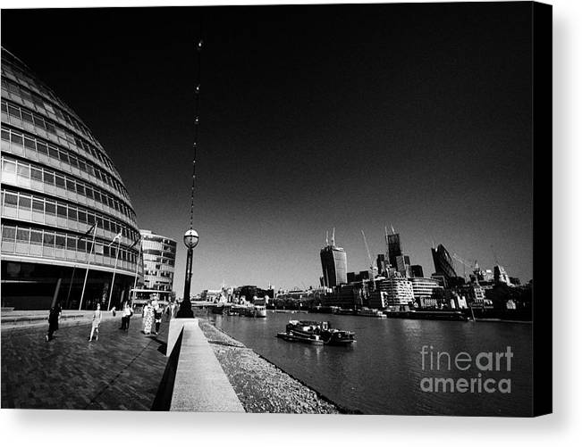 London Canvas Print featuring the photograph London City Hall On The Banks Of The River Thames With Views Of The City Of London England Uk by Joe Fox