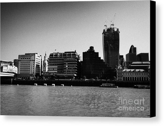 Looking Canvas Print featuring the photograph looking across the river thames at the city of London England UK by Joe Fox