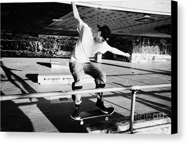 Skateboard Canvas Print featuring the photograph skateboarder at the undercroft skate park of the southbank centre London England UK by Joe Fox