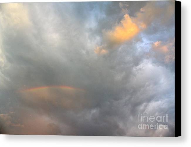 Clouds Canvas Print featuring the photograph Somewhere by Jay Nodianos