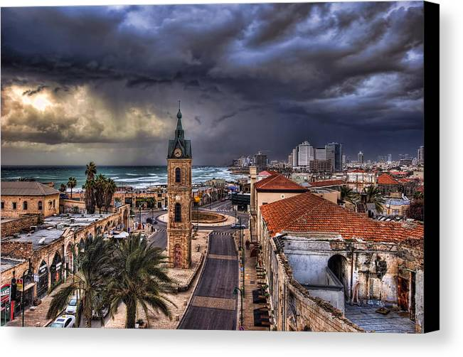 Clock Tower Canvas Print featuring the photograph the Jaffa old clock tower by Ronsho