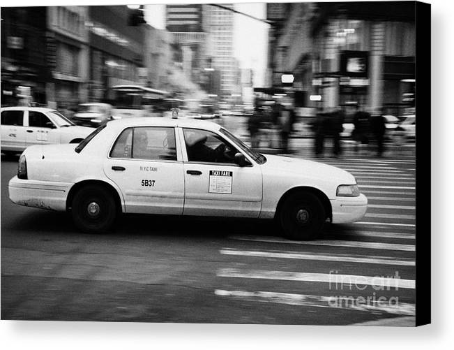 Usa Canvas Print featuring the photograph Yellow Cab Blurring Past Crosswalk And Pedestrians New York City Usa by Joe Fox